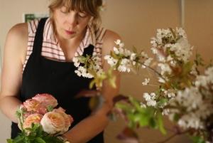 Anna demonstrating arranging ranunculus flowers