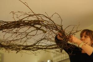 Anna installing a beech ceiling corona decoration