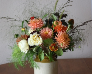 Autumn arrangement of grasses and dahlias