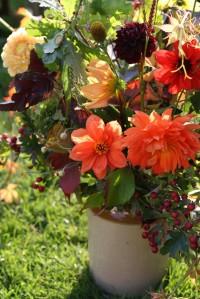 Autumn vase of dahlias, berries and foilage