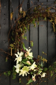 Baptism door wreath with tulips, narcissus and hellebores