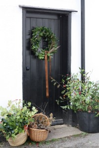 Christmas wreath and foraging baskets around door
