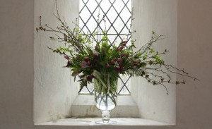 Easter arrangement of tulips, hellebores, willow and branches for church