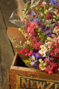 Hand-tied Larkspur posies in crate